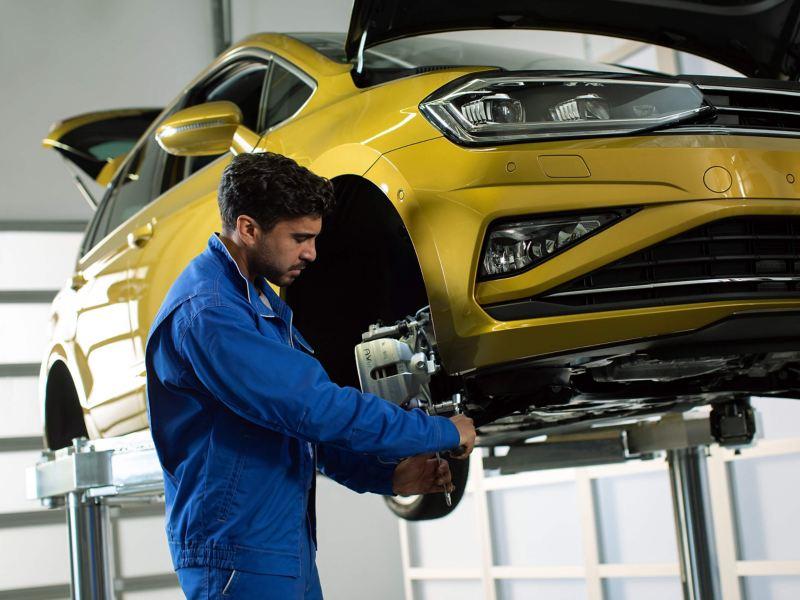 A Volkswagen technician servicing a car