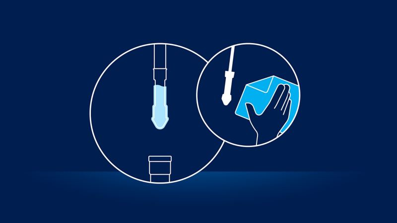Illustration of an oil dipstick and the advice to clean it: checking the oil level