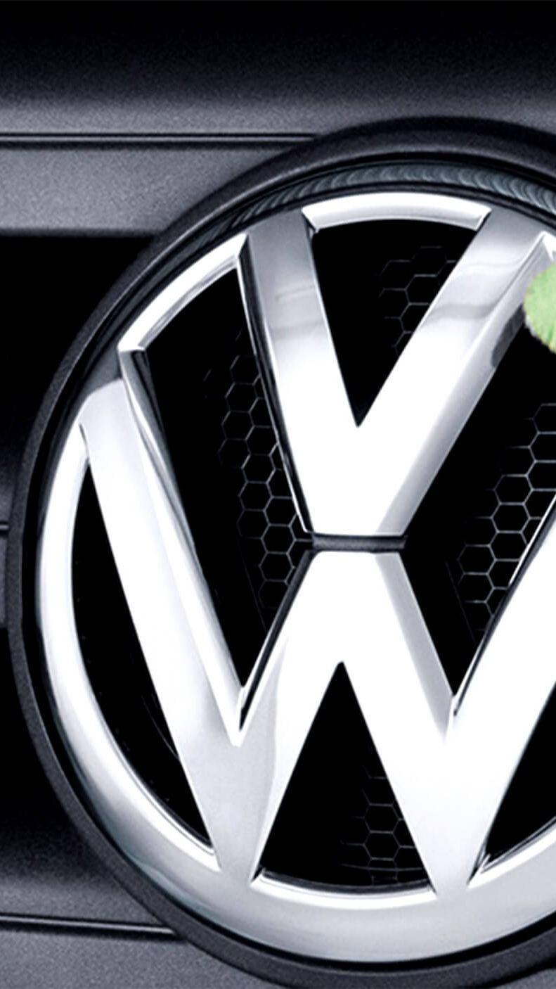Volkswagen badge being polished