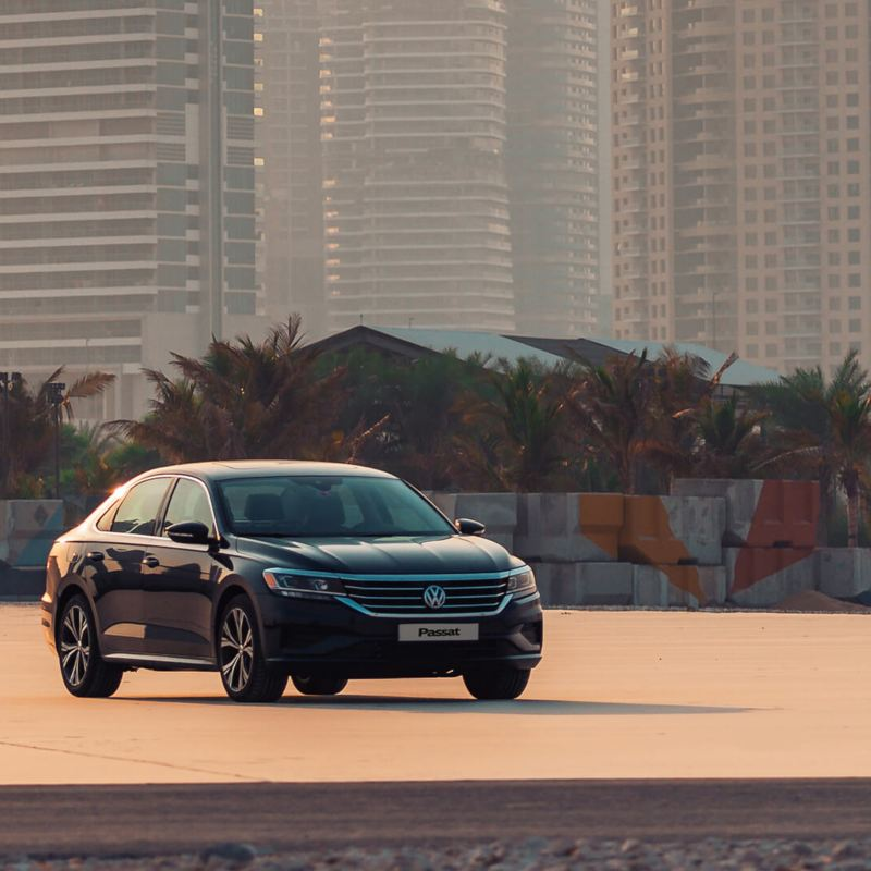The 2020 Volkswagen Passat parked on a habor overlooking the city of Dubai