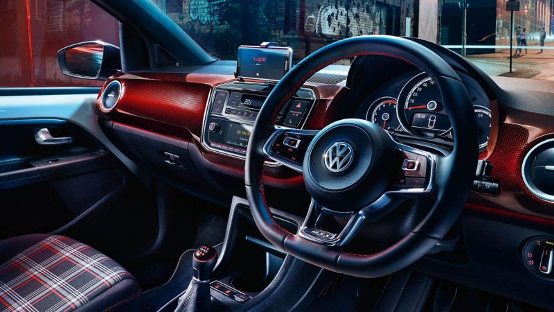 Interior shot of the Volkswagon up! dash board and steering wheel