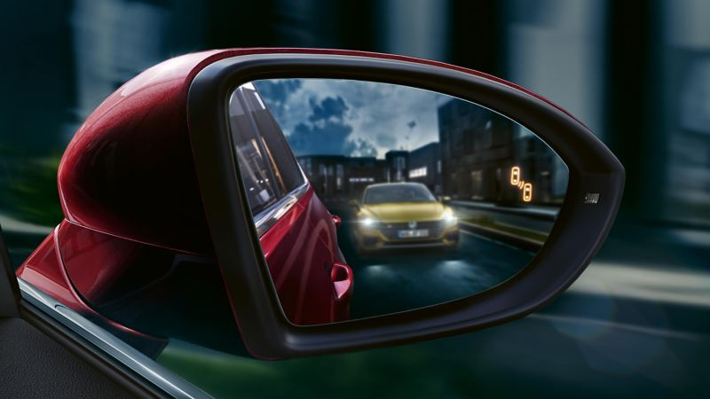 Shot of Volkswagen car reflected in a wing mirror