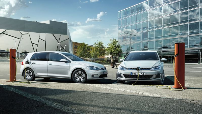 An e-Golf and Golf GTE being charged