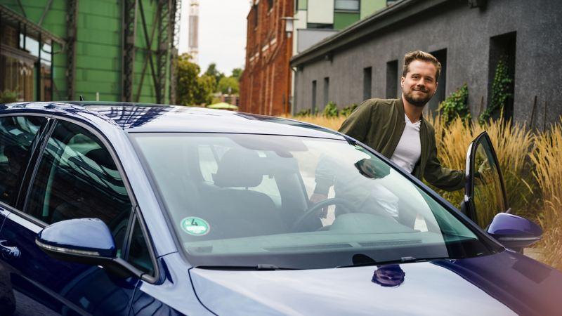 A man going into his car