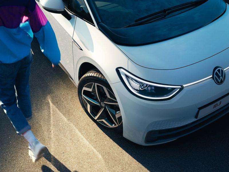 A man entering his Volkswagen ID. 3.