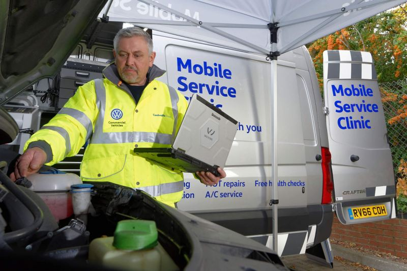 Mobile Servicing Clinic Van and technician in hi-vis jacket