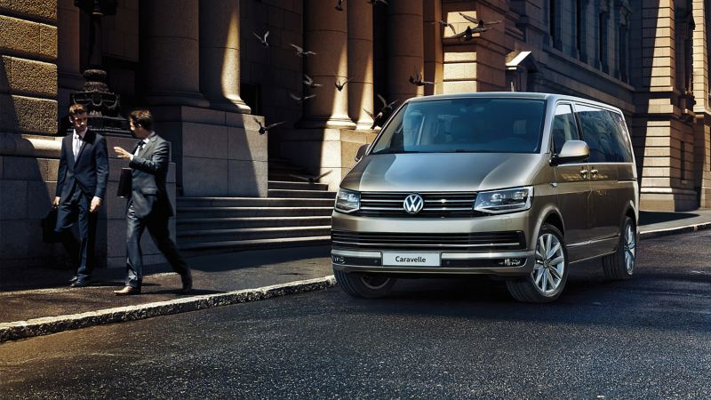 VW Caravelle parked outside building