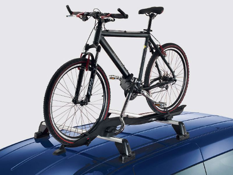Roof-bar-mounted bicycle holder attaches bicycle to VW van roof