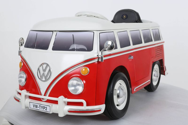 Volkswagen T1 electric bus toy in red and white.