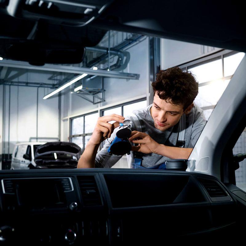 Technician working on van windscreen