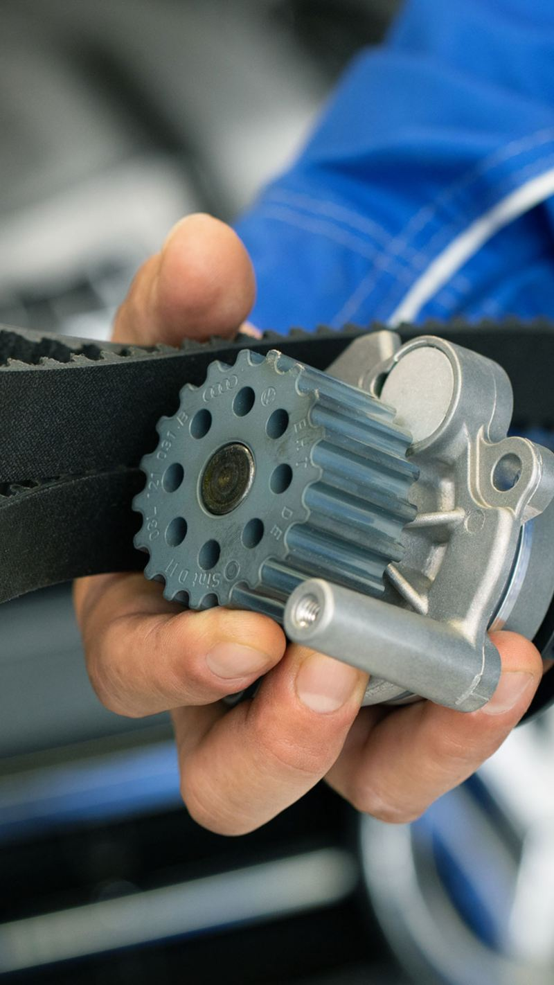 Closeup of technicians hand holding car parts