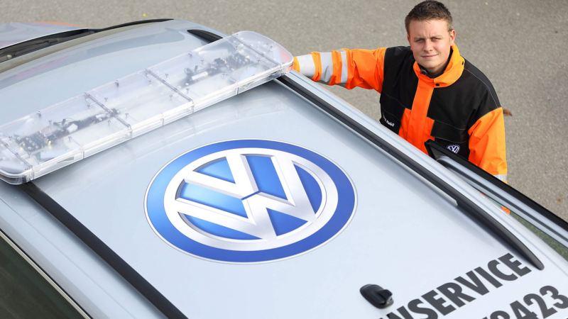 Man standing next to roof of VW Service van (ariel view)