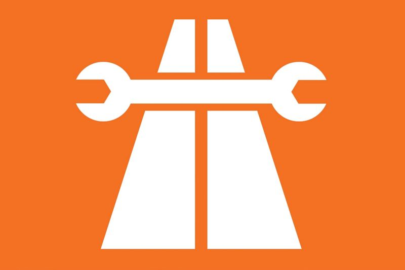 White spanner across two parallel white lines on orange background