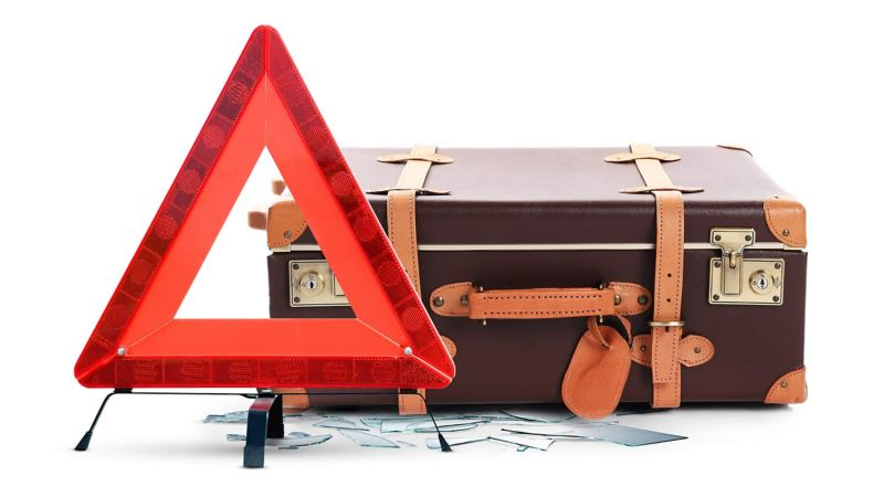 Suitcase with breakdown road sign