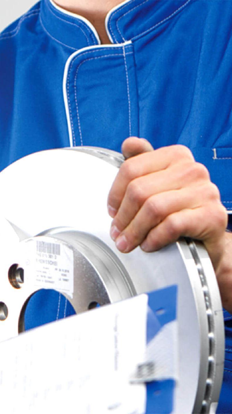 Technicians handling brake disc