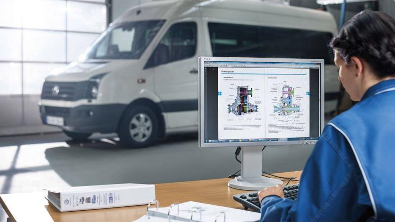 Technician diagnosing a vehicle at a Van Centre