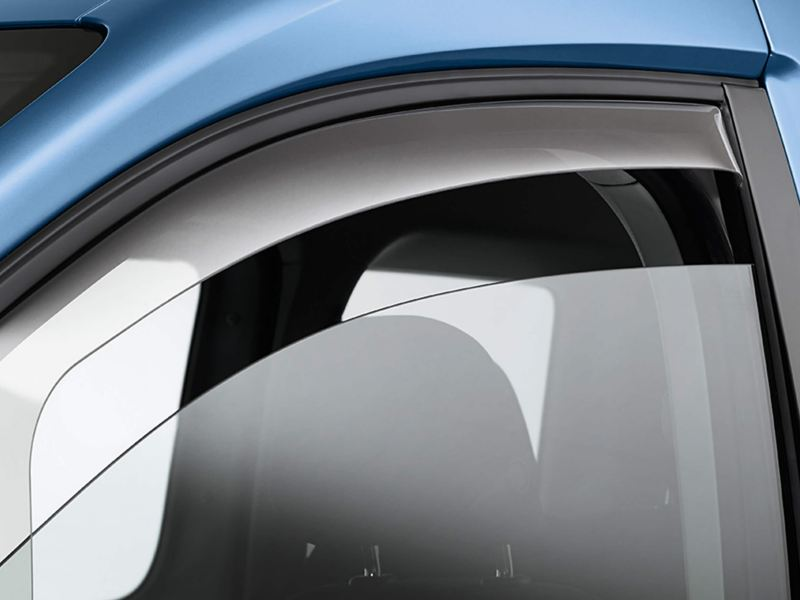 partially open window with wind deflectors