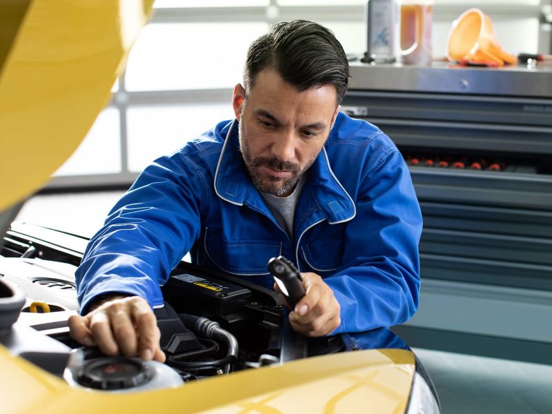 A mechanic repairing a car