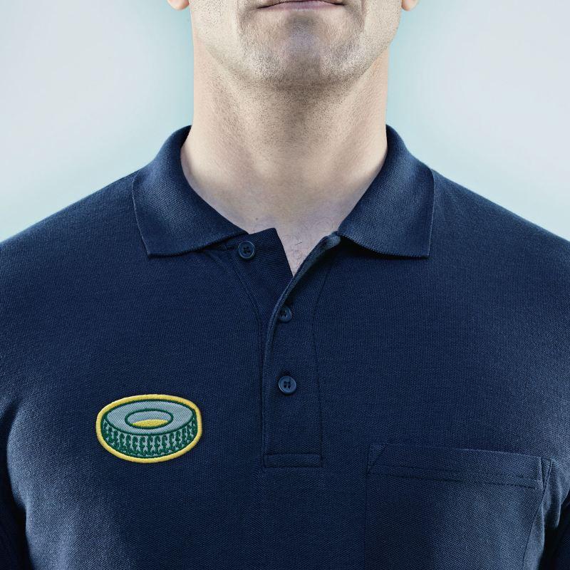 A man wearing a t-shirt with a tyre motif