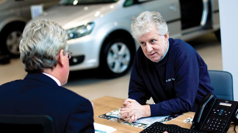Customer discussing Volkswagen insurance in a Van Centre