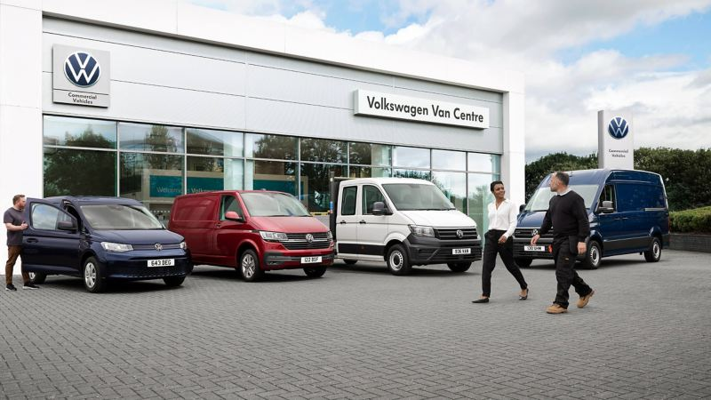 Customer and van dealer outside Volkswagen dealership