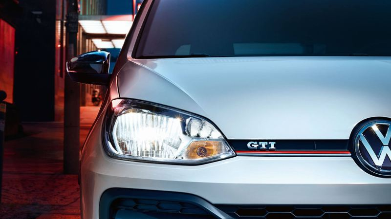 Close up of the front of a sliver Volkswagen e-up! GTI