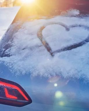 a heart is drawn on the snow