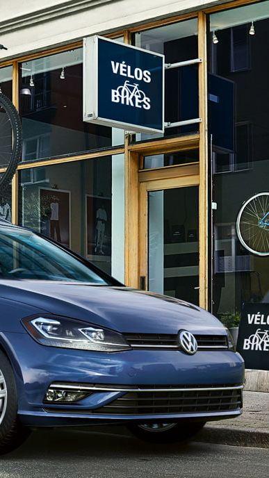 Golf SportWagen in front of a shop