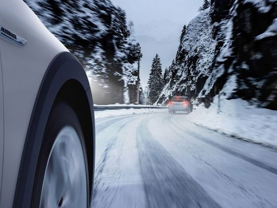 The Volkswagen Golf Alltrack driving in the snow