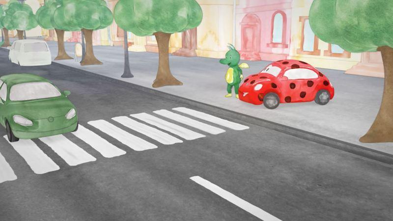 Tabaluga und Käfer stehen am Zebrastreifen und warten, dass Autos anhalten