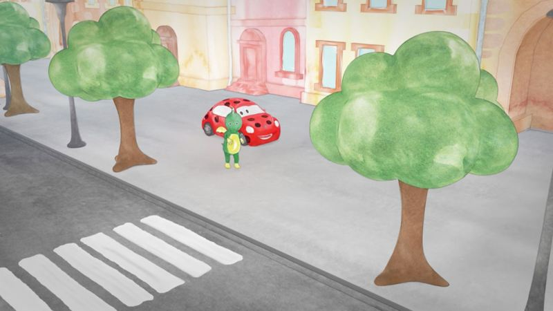 Tabaluga und Käfer gehen zusammen auf dem Fußgängerweg