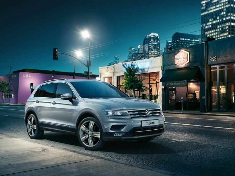 3/4 front view of a silver Volkswagen Tiguan.