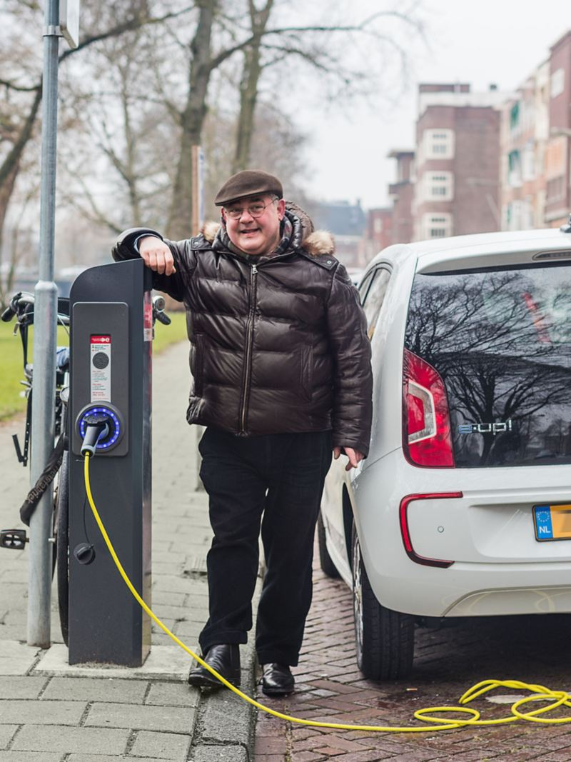 Paul Juda next to a charging station