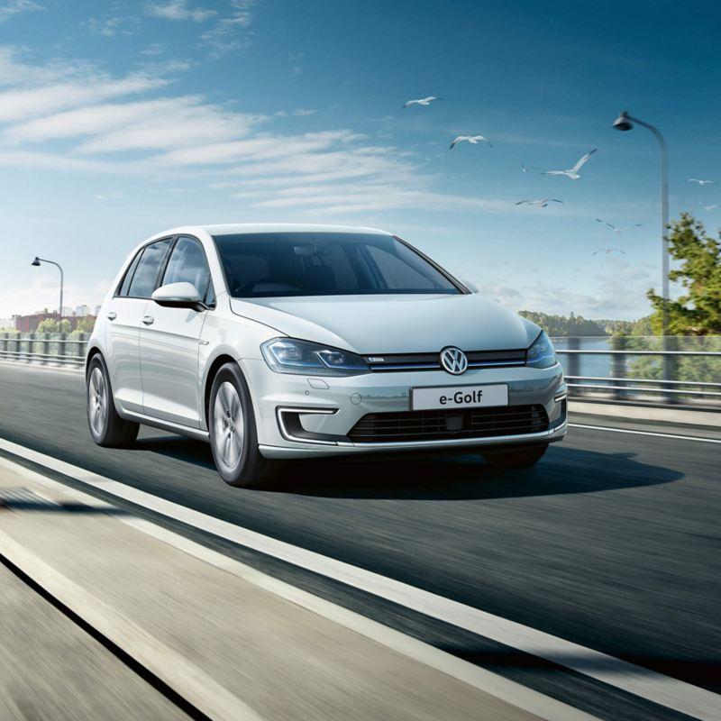 Volkswagen car driving on road