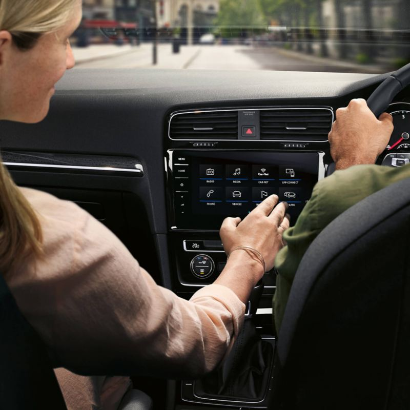 Woman playing with infotainment system