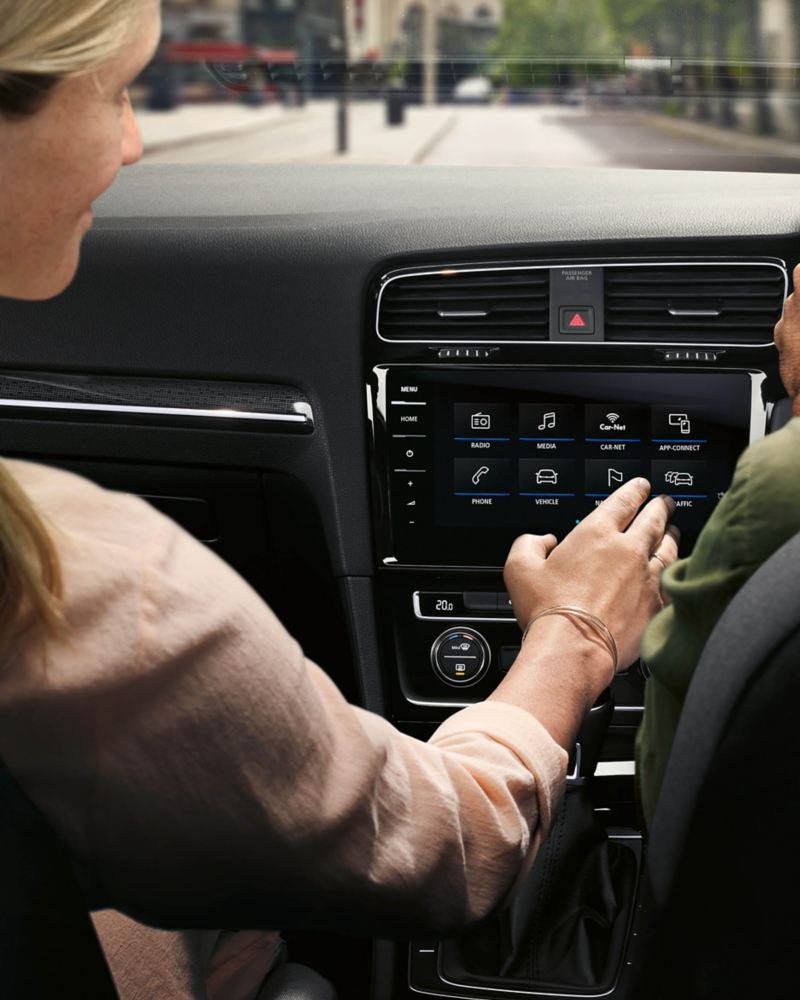 Woman using Car Net App Connect  in Volkswagen car
