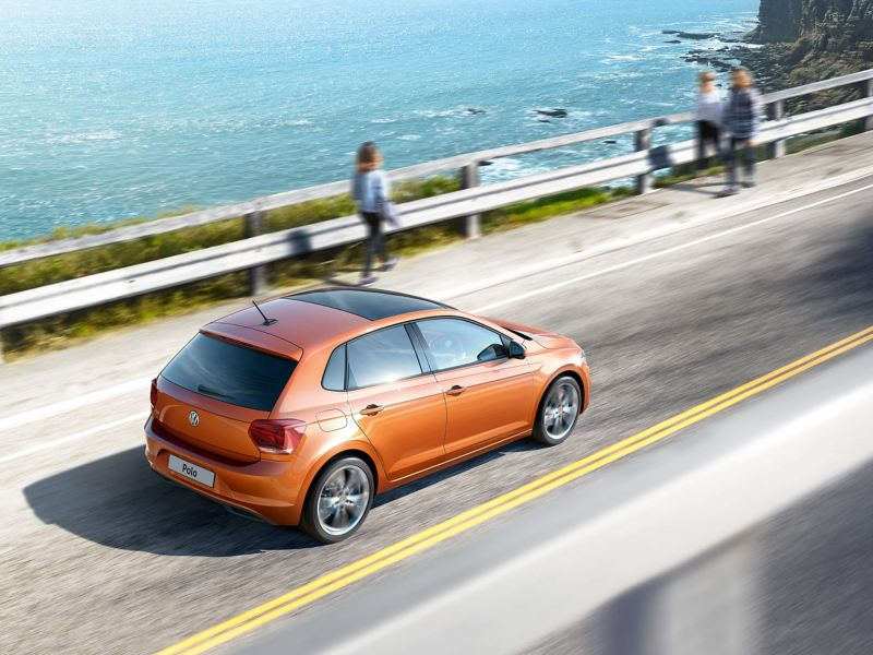 Volkswagen Polo driving by the sea