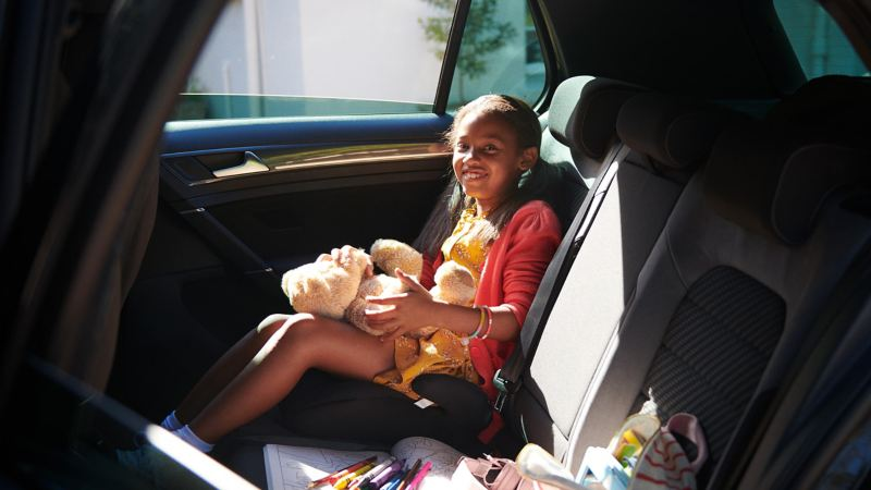 Young child in the rear of a Volkswagen car