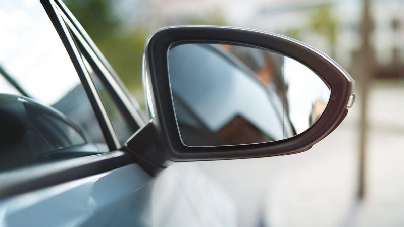 Wing mirror shot of car behind