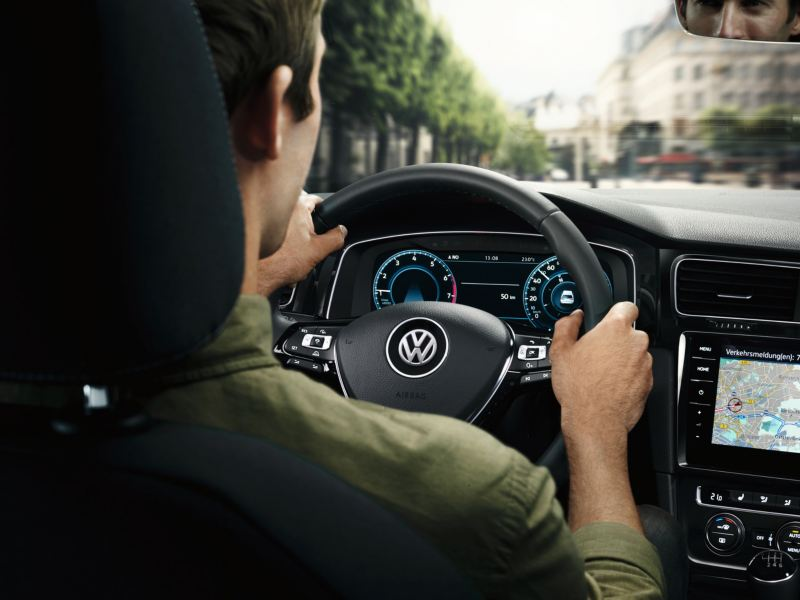 Man driving Volkswagen car