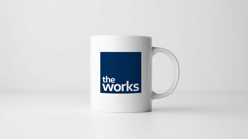 the_works_mug_on_grey_background