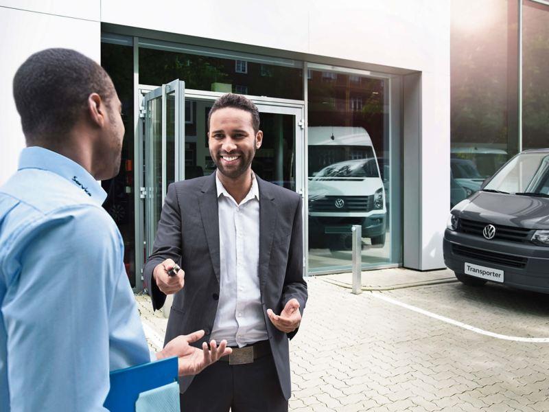 customer_handing_keys_to_salesman