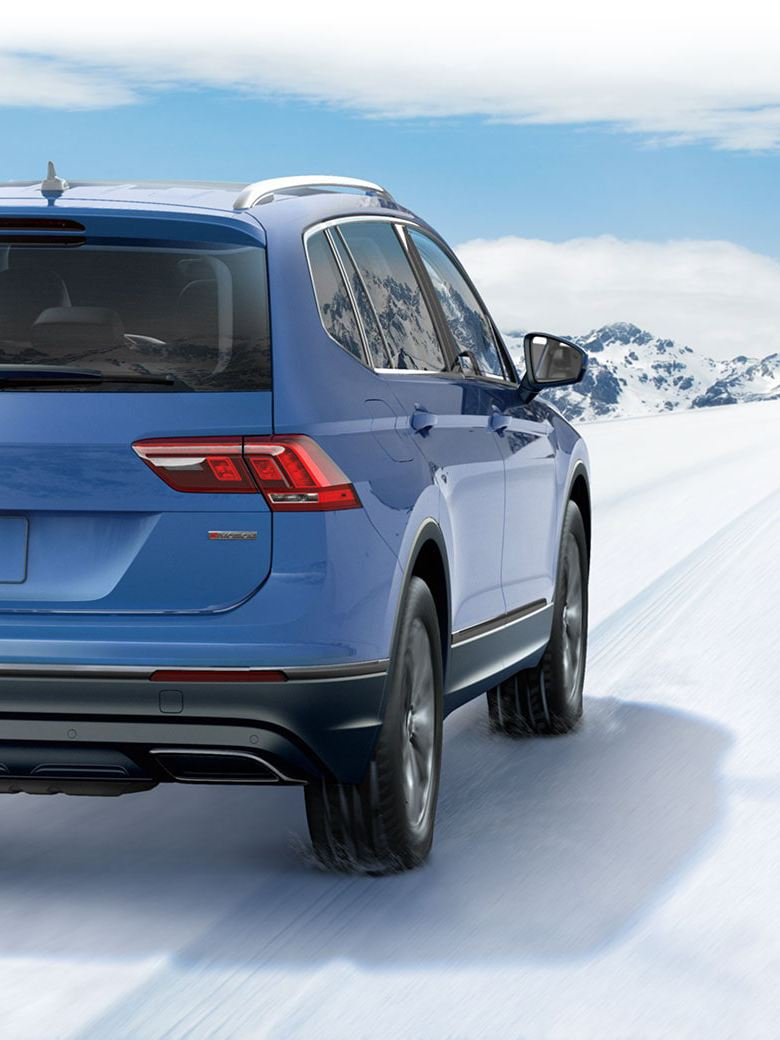 A Tiguan on a snowy road