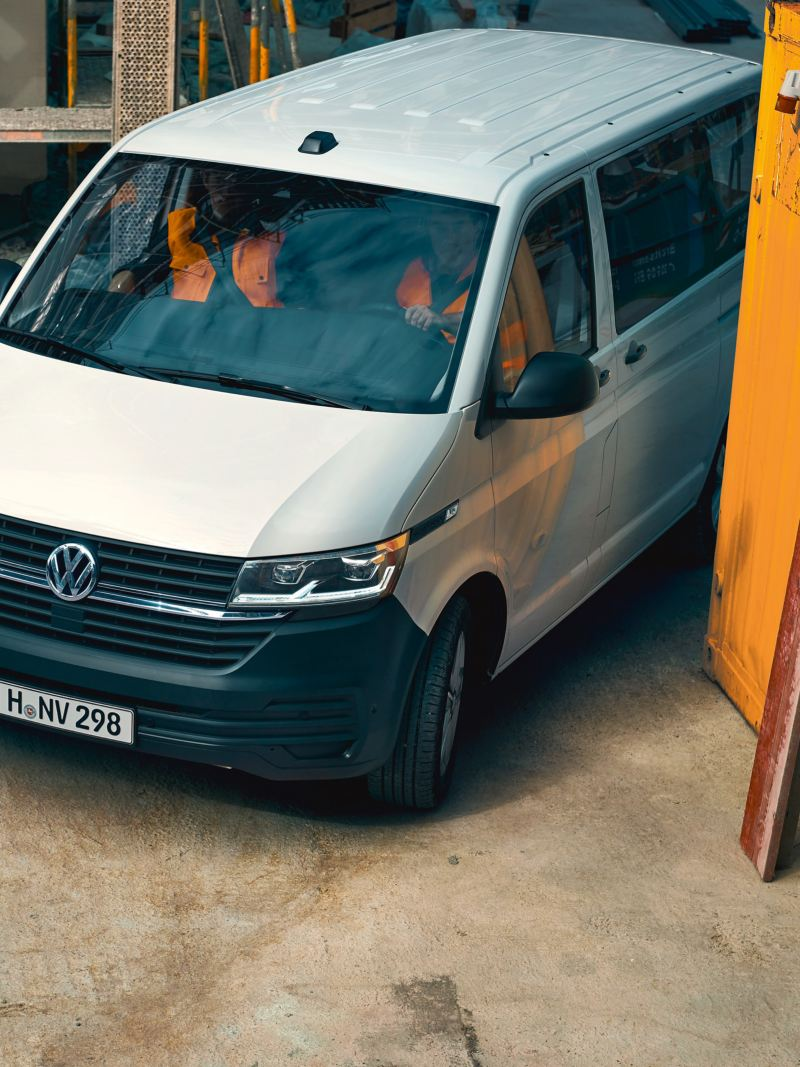 A Volkswagen Transporter 6.1 Kombi is exiting a construction site.