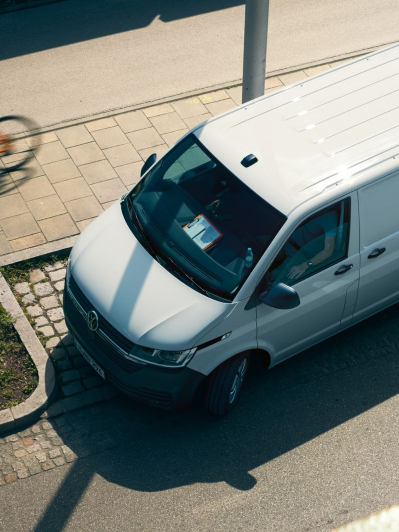 The Transporter 6.1 Delivery Van turns right onto a street.