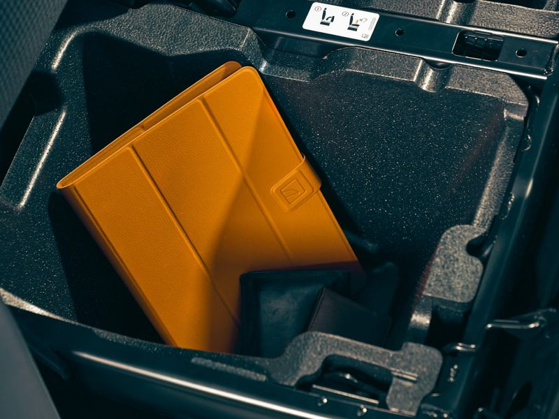 A tablet in a compartment blow the seat.