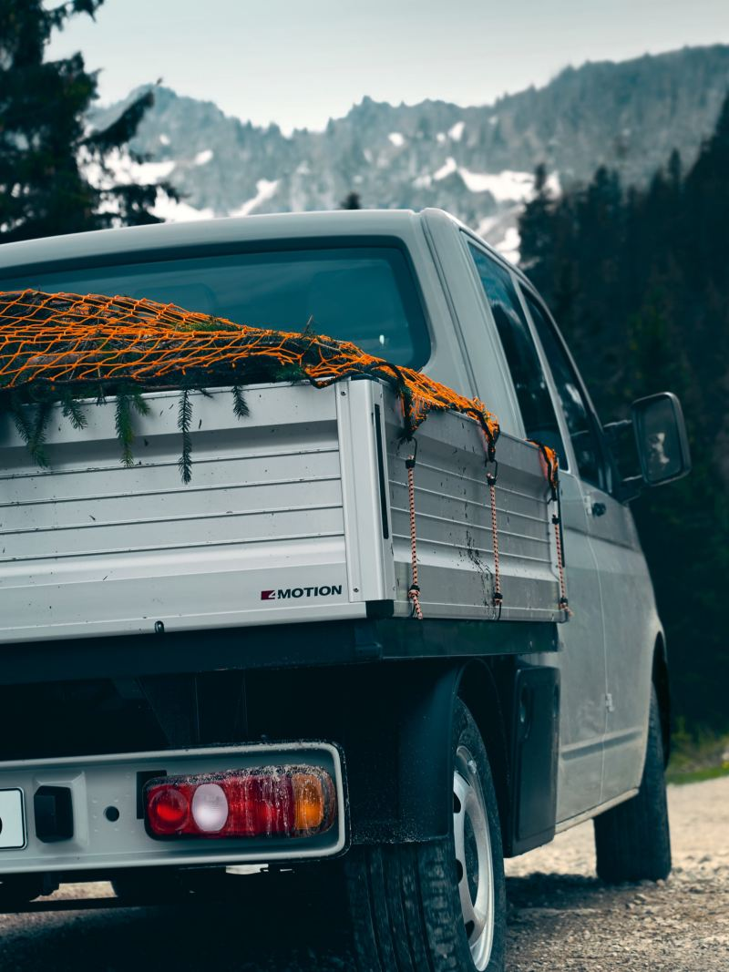 The Transporter 6.1 Dropside Van in used with a secured load.