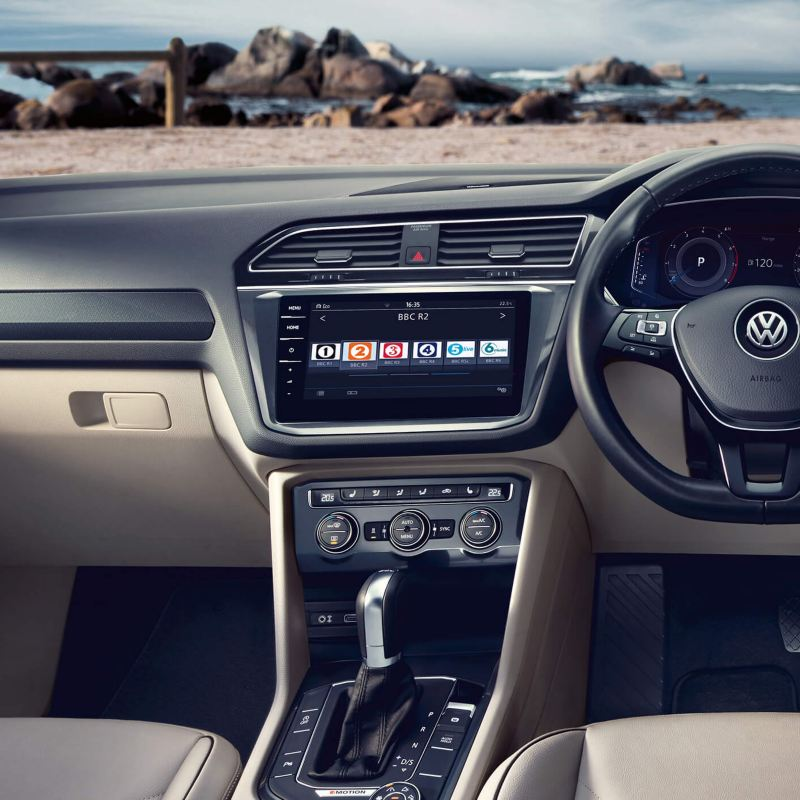 Interior dashboard and steering wheel shot of a Volkswagen.