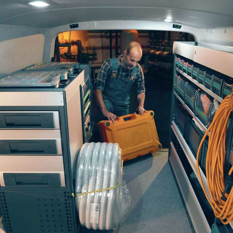 Man getting toolbox from Transporter