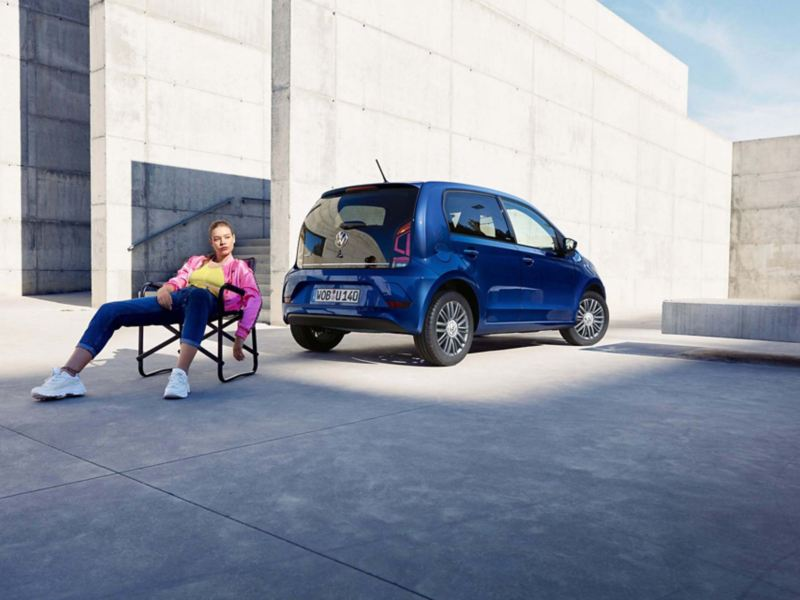 woman sitting in camping chair in front of vw up!
